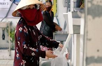 Vietnam'da işsiz kalanlar için pirinç ATM'si icat edildi