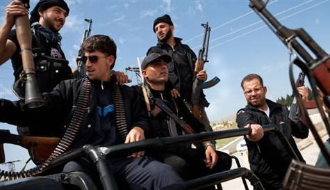 Muhalifler Şam'da çatışıyor, Humus'ta çekiliyor