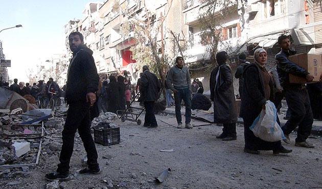 Silah sesleri duyulunca Yermuk'te yardım dağıtımı kesildi
