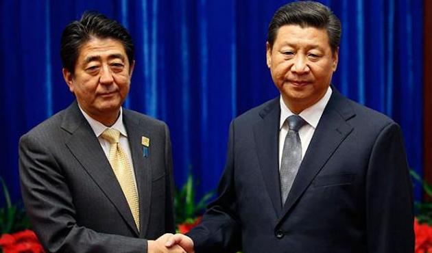 Çin ve Japon liderlerden zoraki toka...
