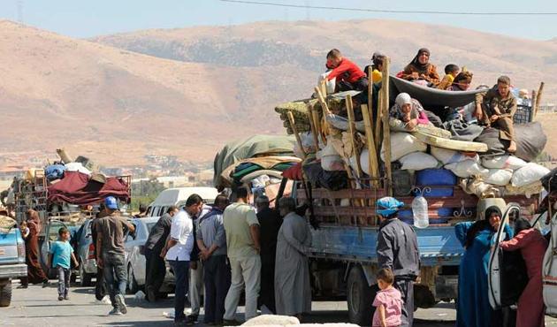 Suriye'de 2014'te yarısı sivil 76 bin kişi öldü