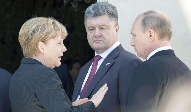 Merkel, Poroşenko ve Putin'le Ukrayna'yı görüştü