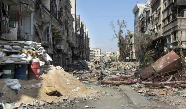Suriye ordusu Yermuk'u varil bombasıyla vurdu