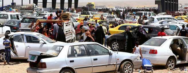 Irak'tan bin 200 mülteci Tikrit'e geri döndü