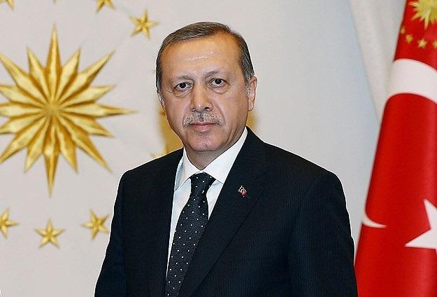 Erdoğan, Yılmaz'ı tebrik etti
