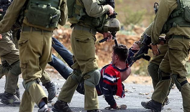 İsrail askerleri 12 Filistinliyi yaraladı