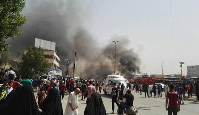 Bağdat'ta pazar yerine bombalı saldırı: 64 ölü
