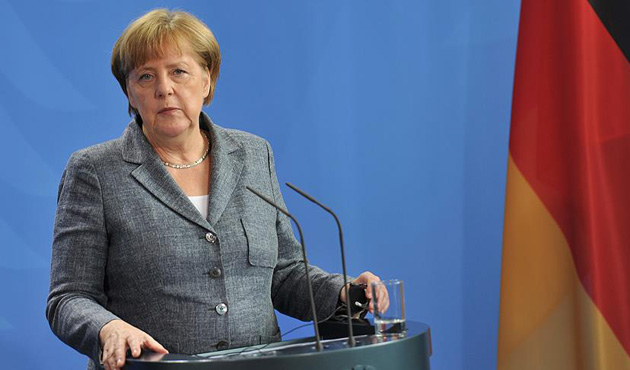 Merkel'den hem uyarı hem destek...
