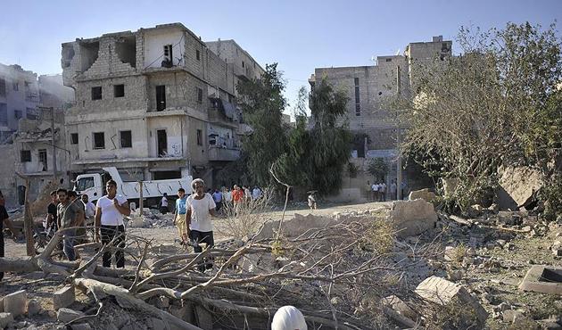 Muhalifler ve siviller Halep'i terk etmiyor