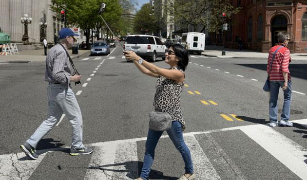 Selfie çılgınlığının sonu: ABD'lilerin yarısının polis kaydı var