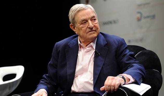 Soros: AB İtalya'ya aldığı göçmenler için tazminat ödemeli