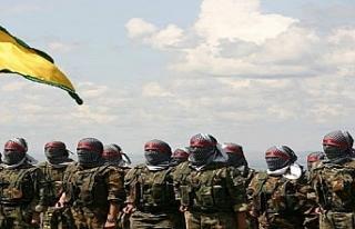 YPG militanı sivillere yardım eden ABD askerini...