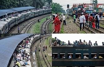 Binlerce Bangladeşli her gün işe tren üzerinde gidiyor