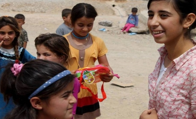 Halepçe'de çocuklar savaş kalıntılarıyla oynuyor