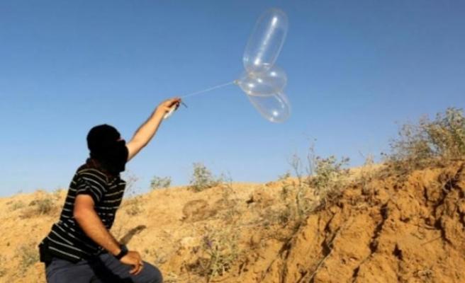 Gazze'den İsrail tarafına yeniden ateş balonları atıldı