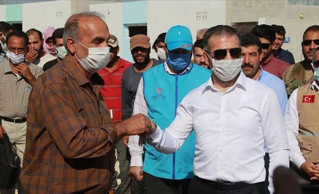 Türkiye Diyanet Vakfı'nın yaptırdığı evler sahiplerine teslim edildi