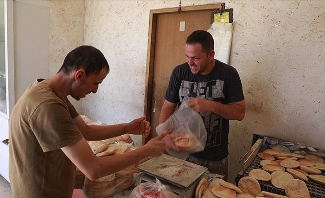 Filistin'de fırın işleten engelli kardeşler engel tanımıyor