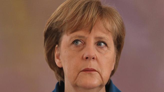 Merkel'den Rusya'ya 'askerlerini çek' talebi