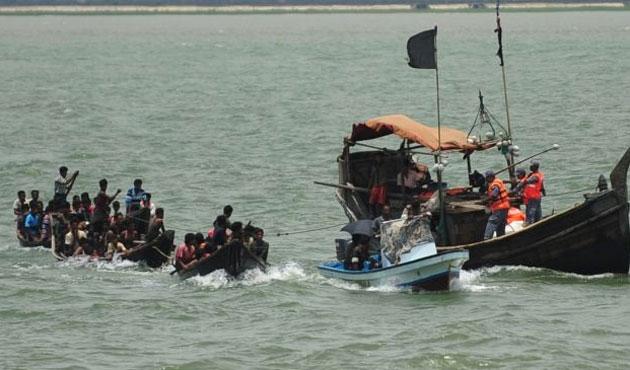 Bangladeşli kaçakları taşıyan tekneye silahlı saldırı