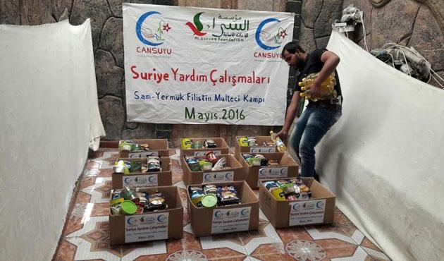 Cansuyu Derneği Yermuk'te yardım dağıttı