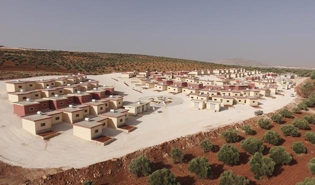 Suriye'de savaş mağduru aileler için 'Rahmet Yaşam Köyü' açıldı
