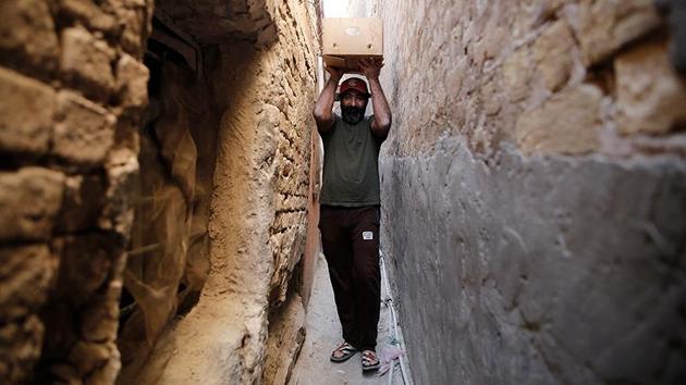 Bağdat'ın 'en dar sokağı'nda zorlu hayat mücadelesi