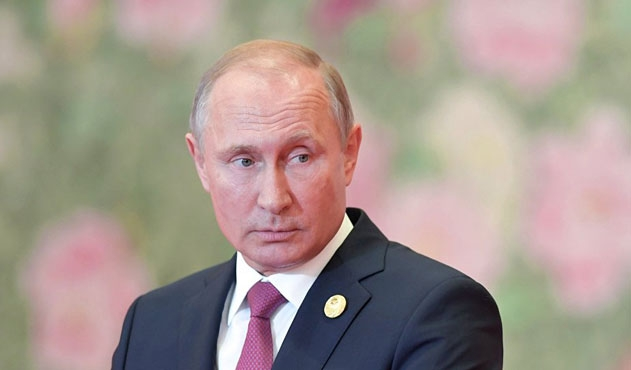 Putin Tanrı'ya ne zaman inandığını açıkladı